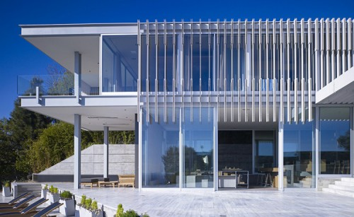 Modern detached house, West Hollywood, California. Exterior terrace with planters