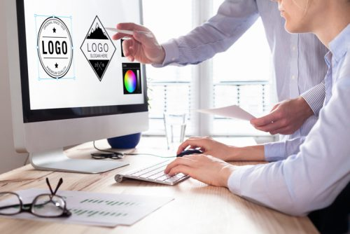 Designer team sketching a logo in digital design studio on computer, creative graphic drawing skills for marketing and branding